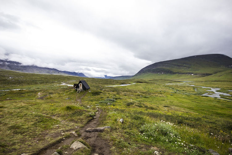 Kungsleden in Sweden Lappland Sweden Activity Beauty In Nature Cloud - Sky Day Environment Grass Green Color Idyllic Landscape Mountain Mountain Range Nature No People Non-urban Scene Outdoors Outdoors Photograpghy  Scenics - Nature Sky Tranquil Scene Tranquility