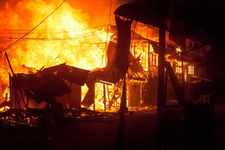 Coffee shop burning at night