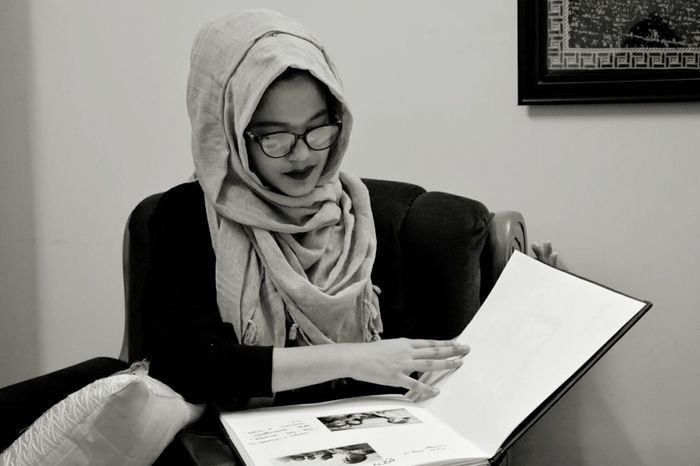 Going through the old memories! One Woman Only Indoors  Black & White Cheerful Monochrome Photography Place Of Heart Candid Portraits Faces Of Friends Friendship Hijabbeauty Live For The Story The Portraitist - 2017 EyeEm Awards Nostalgia Stop Motion Happiness Smiling Lifestyles Embrace The Moment The Photojournalist - 2017 EyeEm Awards EyeEmNewHere EyeEm Selects Film Photography Black And White Friday