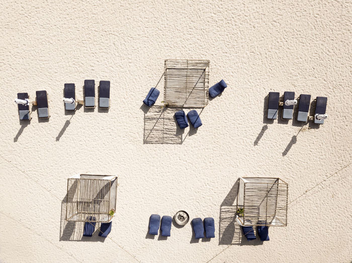 High angle view of chairs on wall