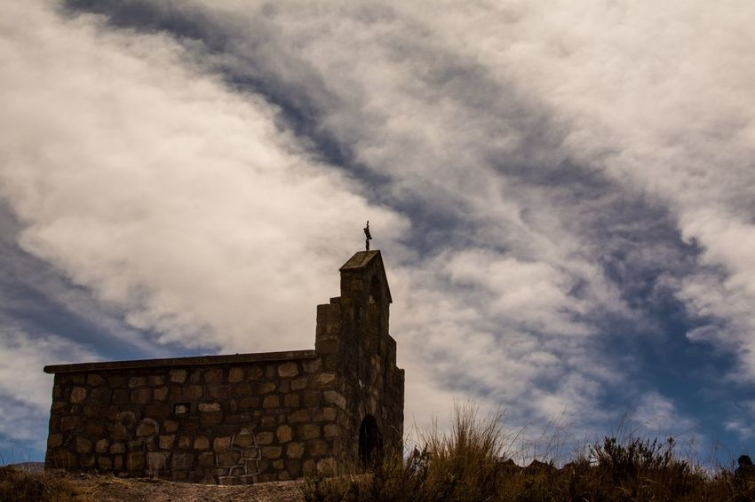 An old church in the middle of nowhere Nature On Your Doorstep Autumn Low Angle View Dramatic Sky Church Architecture Built Structure Cloud - Sky Sky Building Exterior Building Low Angle View Religion Spirituality Belief Nature Place Of Worship History Tower No People Outdoors Day The Past Nature Stone Wall Wall Architecture