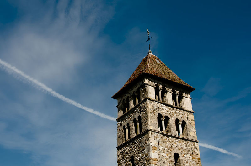 Low angle view of old church against blue sky