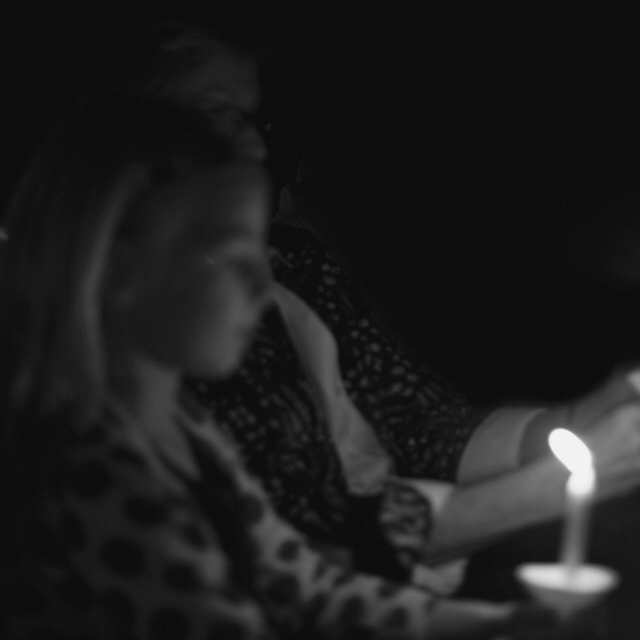candle, flame, burning, indoors, real people, lifestyles, illuminated, togetherness, headshot, childhood, close-up, night, human hand, young adult, people