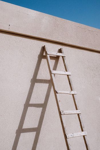 Follow the ladder. Minimalism Minimal Wall Shadows Shadow And Light Shadows & Lights Streetphoto Minimalist Streetphotography Ladder EyeEm Selects High Angle View Day Sunlight No People Shadow Built Structure Outdoors Pattern Triangle Shape Shape Design Sunny