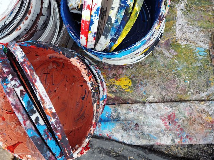 High Angle View Of Empty Colorful Paint Buckets