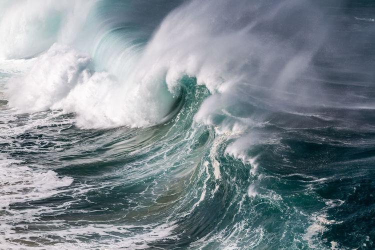 A Big wave at Waimea bay on the north shore of Oahu Hawaii Breaking Hawaii Oahu Pacific Surf Surf's Up Beach Beauty In Nature Crashing Day Force Hawaiian Motion Nature No People North Shore Ocean Outdoors Power In Nature Sea Seascape Splashing Waimea Bay Water Wave