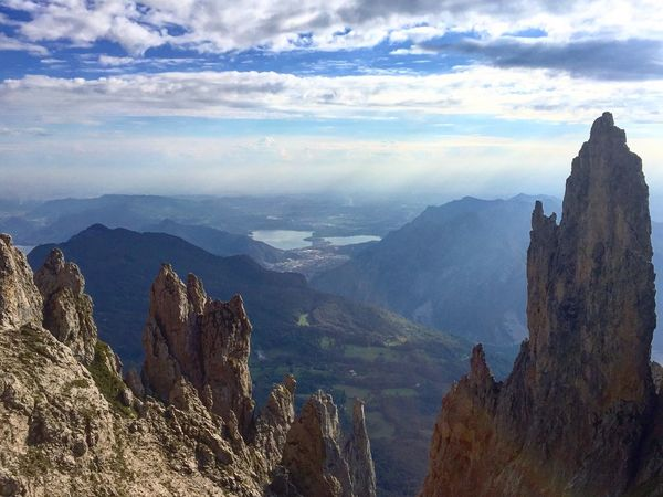 Mountain Scenics Tranquil Scene Beauty In Nature Tourism Mountain Range Tranquility Travel Destinations Physical Geography Sky Non-urban Scene Idyllic High Angle View Travel Majestic Nature Cloud - Sky Geology Dramatic Landscape Water Lombardia Italy