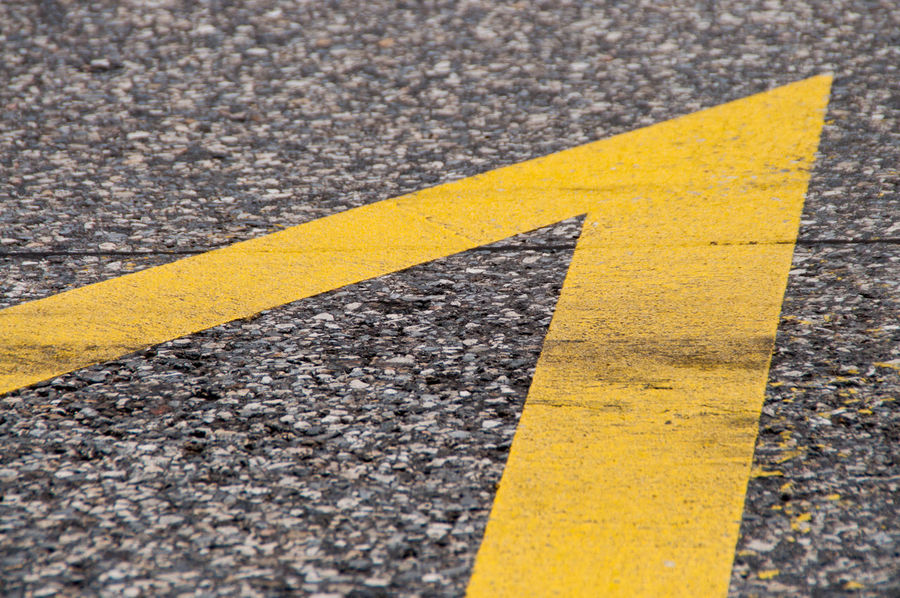 Abstract Arrow Asphalt Close-up Composition Day Detail Diagonal Direction Geometric Shapes Geometry Grain No People Paint Raw Road Road Marking Rough Signal Street Street Photography Streetphotography Surface Level Yellow