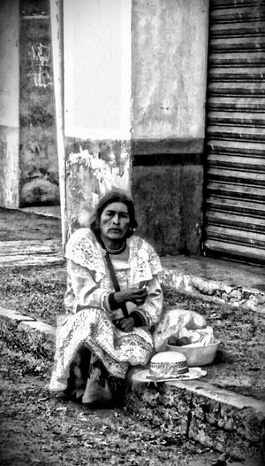 Sitting Real People One Person Looking At Camera Women Social Issues People Portrait Front View Native Pride Old Town Old Woman Sad Face Sadness Poverty Traditional Taking A Break