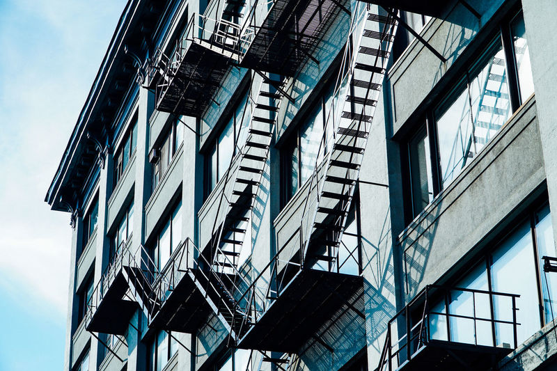 Architecture Architecture Architecture_collection Building Building Exterior Built Structure Day Fire Escape Fire Escape Fireescape Light And Shadow Low Angle View No People Outdoors Reflection Shadow Sky Urban Urban Exploration Urban Geometry Urbanphotography Windows