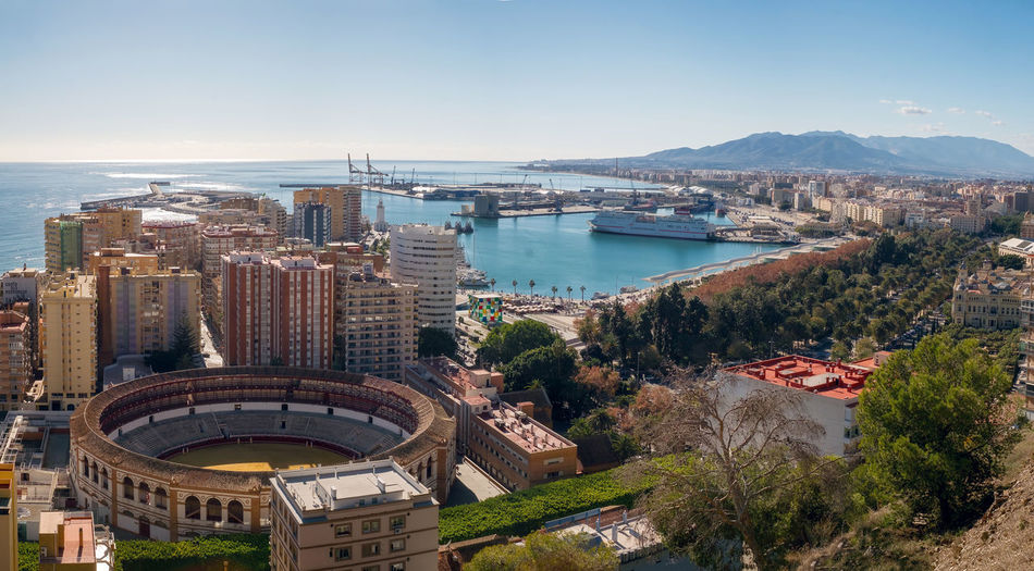 Panoramic view of the Malaga city and harbor, Spain Port Andalucía Arena Harbor Malaga Malaga Spain Mediterranean  Mediterranean Sea Palms Trees Arena Costa Del Sol Destination Hotel Hotels And Resorts Ships Toreadore Turistic Turistic Places
