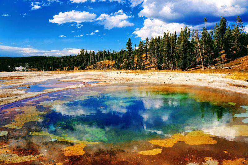 Hot spring against sky