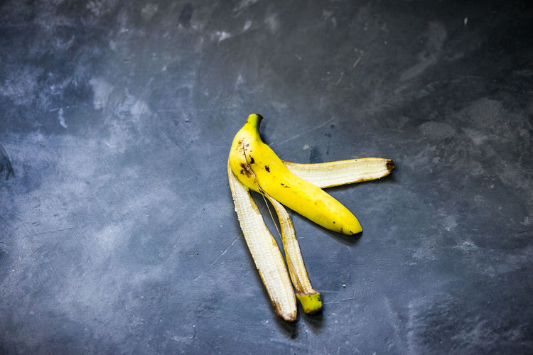 Directly above shot of banana peel on gray table