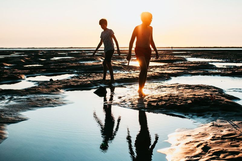 Water Sky Sunset Beauty In Nature Beach Sea Land Two People Men Real People Reflection Nature Lifestyles Leisure Activity Scenics - Nature Togetherness Horizon Over Water Friendship Standing Outdoors