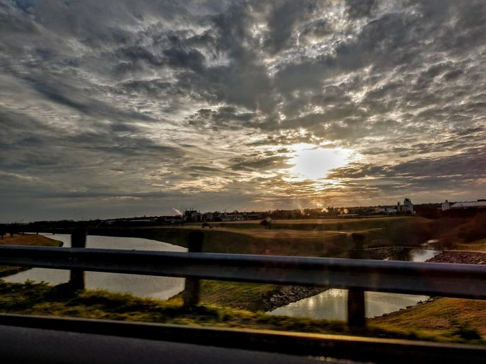 Western sunset Fromabridge Celaje Clouds Nopeople Water Sunset Rural Scene Illuminated Bridge - Man Made Structure Reflection River