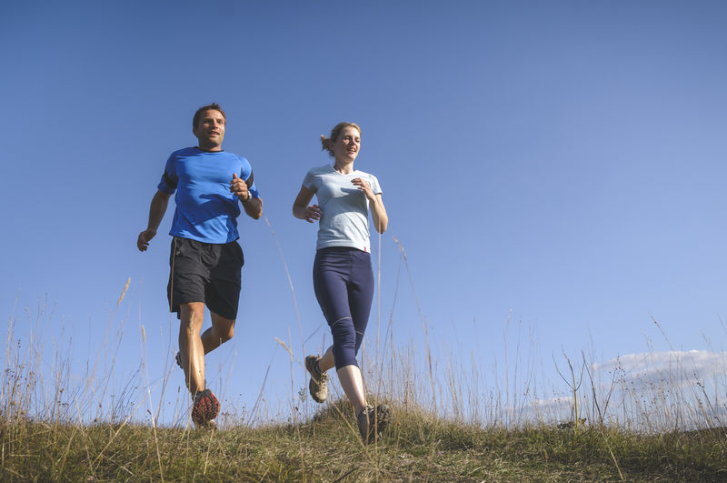 Personal Training Personal Training Running Woman Adult Clear Sky Couple - Relationship Fitness Fitness Training Friendship Full Length Jogging Leisure Activity Low Angle View Men Nature Outdoors Personal Trainer Positive Emotion Running Sport Sports Clothing Together Togetherness Two People Young Adult