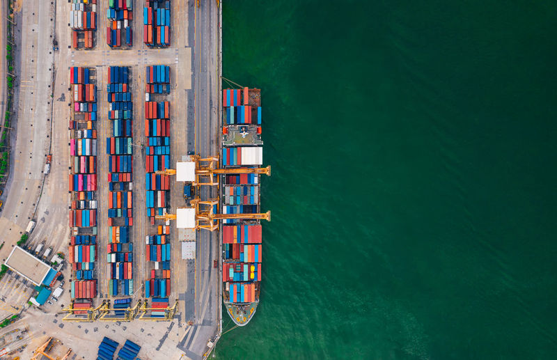 Aerial view from drone logistics and transportation of container cargo ship and cargo import export