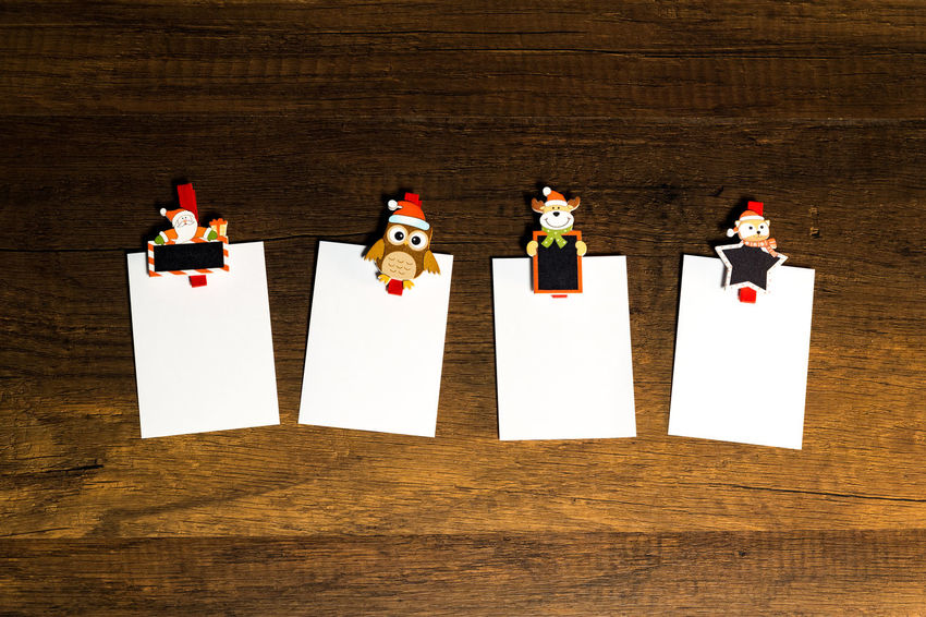 Blank paper sheet with Christmas theme paper clip Celebration Christmas Holiday Reindeer Santa Season Greetings Blank Paper Owl Paper Clip Snow Man White Paper Wooden Background X Mas