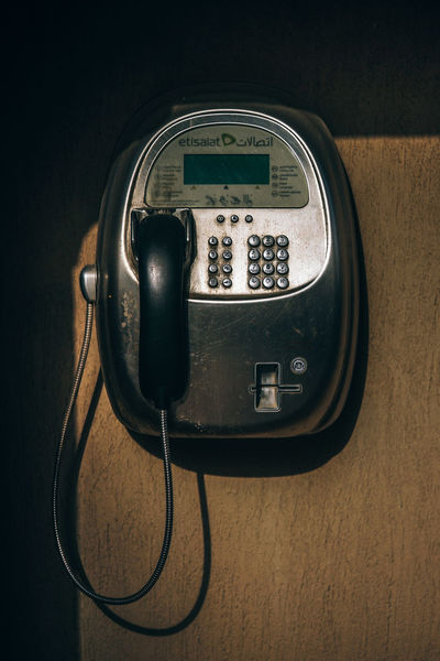 Retro Payphone in Dubai Business Button Communicate Communications Retro Background Black Cable Call Close-up Closeup Coin Communication Connection Day Dial Handset Indoors  No People Pay Phone Payphone Technology Telecommunications Equipment Telephone Telephone Receiver