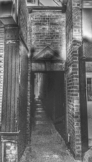 Forgotten Alleyways this photo was so dark from the shadow cast .. but I think ... It's ok .. a little lights but .. Backstreets & Alleyways Old Town Old Alleyways Crest Whats This? Carving Top Secret Mission Old Buildings