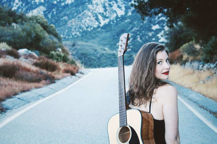 Morning hike with Ms. Crepes. Young Adult Young Women Long Hair Lifestyles Waist Up Looking At Camera Street Portrait Mountain Beauty Hike Guitar Red Lips California Cool Tones