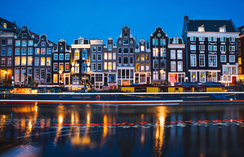 Amsterdam Amsterdam Canal Amsterdamcity Architecture Building Building Exterior Built Structure City Dusk Illuminated Mode Of Transportation Nature Nautical Vessel No People Outdoors Passenger Craft Reflection Residential District River Sky Transportation Water Waterfront