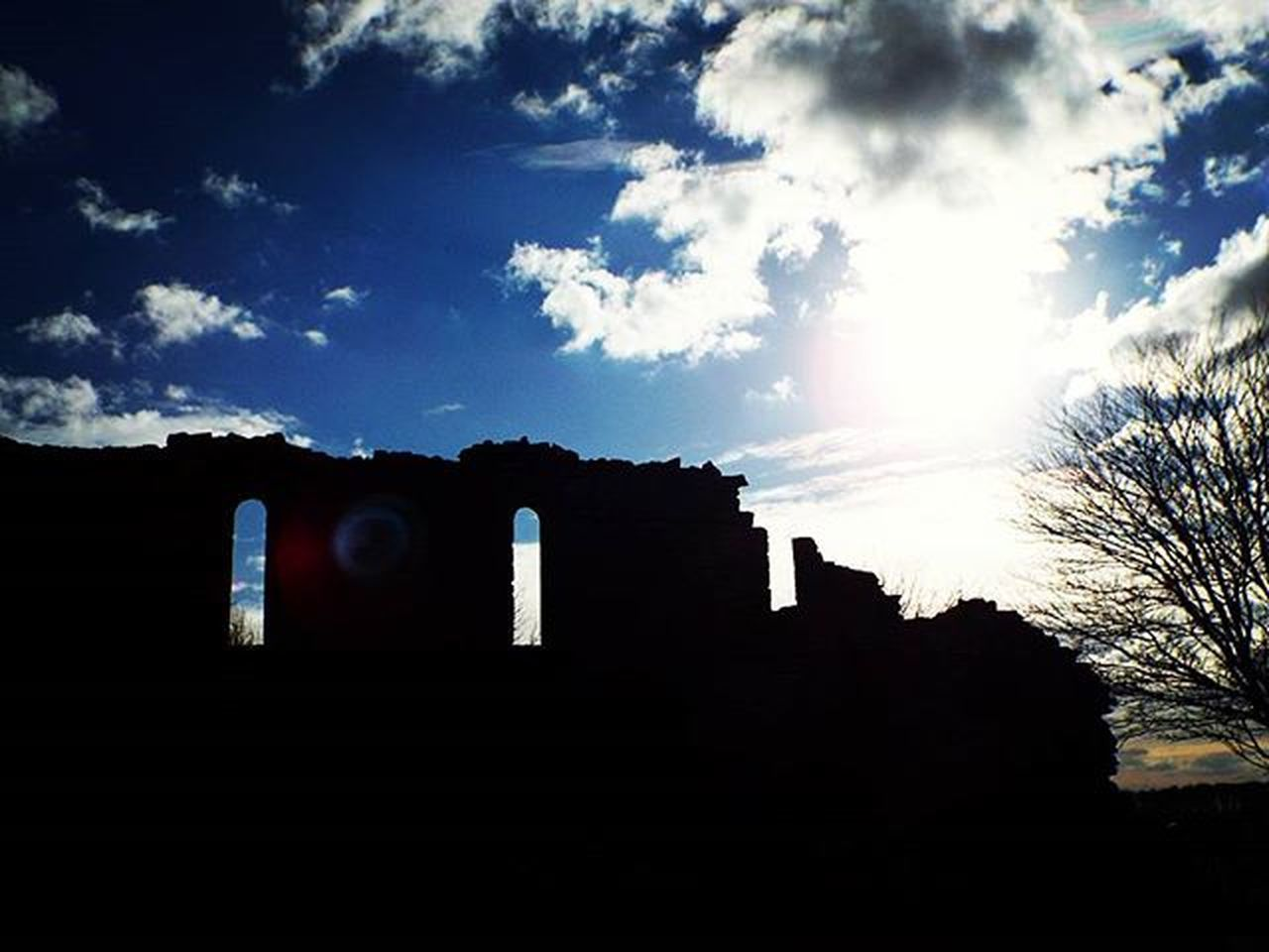 architecture, built structure, building exterior, history, silhouette, sky, cloud - sky, no people, low angle view, ancient, day, outdoors, ancient civilization