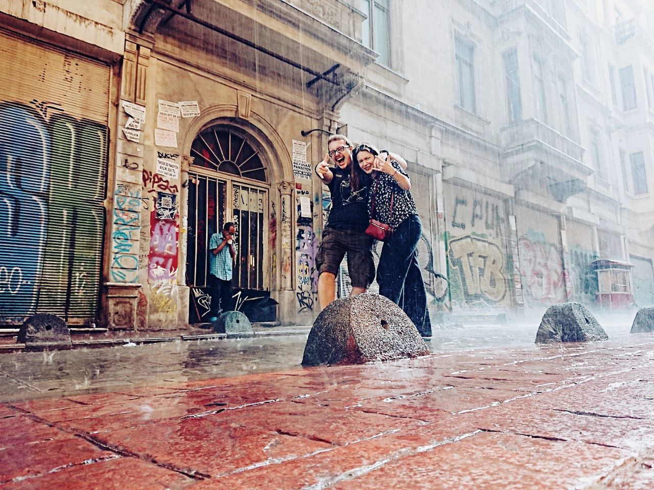building exterior, architecture, real people, men, street, city, built structure, lifestyles, two people, adult, women, day, young adult, winter, people, clothing, young men, building, leisure activity, warm clothing, outdoors, snowing, rain