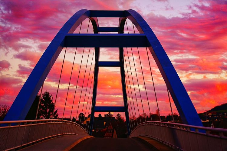 View of suspension bridge against sky during sunset