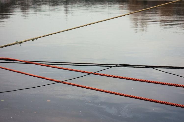High angle view of rope on lake