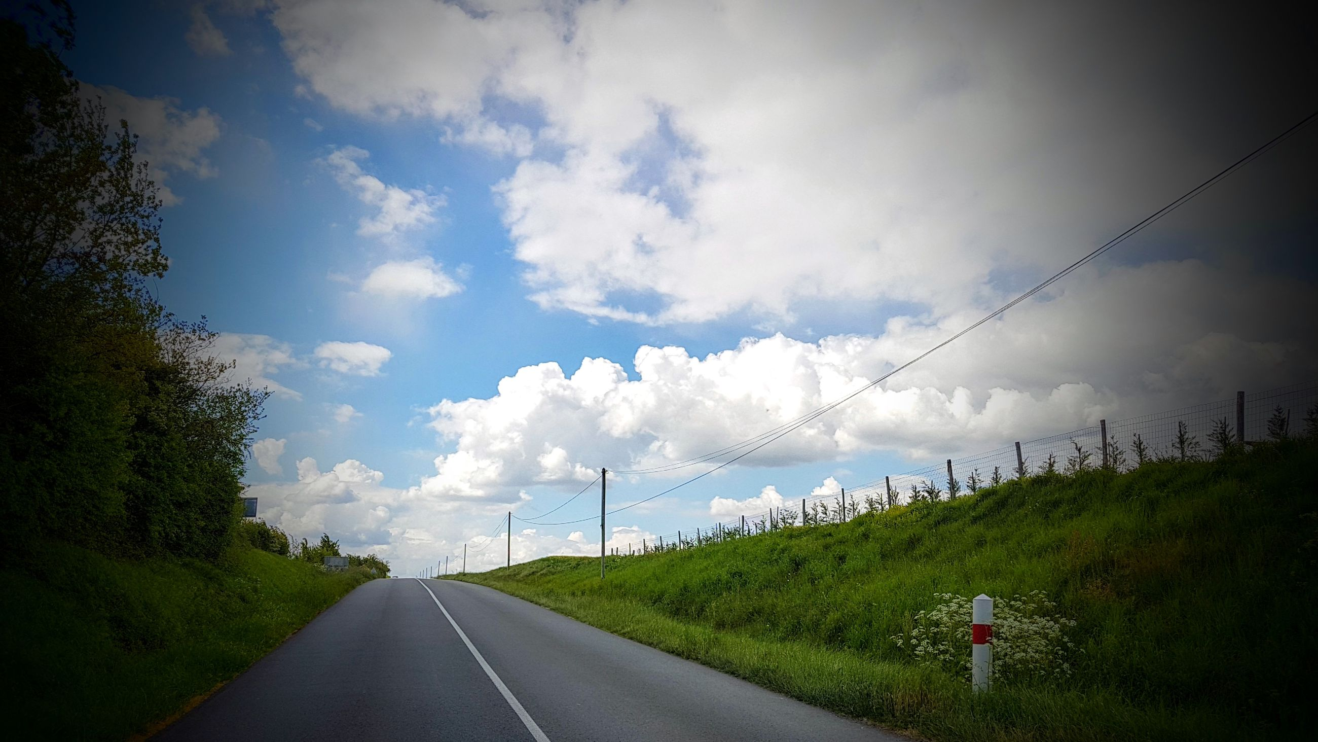 road, transportation, the way forward, sky, cloud - sky, empty road, asphalt, no people, nature, day, outdoors, tree, landscape, electricity pylon, telephone line, beauty in nature