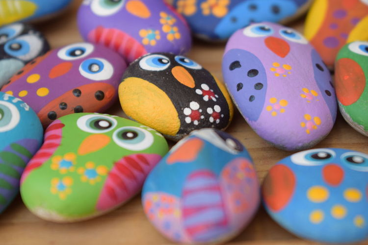Owl Art Art And Craft Choice Close-up Focus On Foreground Gravel Art Group Of Objects Indoors  Large Group Of Objects Multi Colored No People Owls Painted Gravels Pattern Polka Dot Selective Focus Shape Spotted Still Life Table Temptation Variation