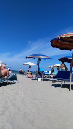 Beach Sea People Vacations Sitting Summer Blue Outdoors Men Water Nature Relaxation Sky Day Orginal Ciao. ✌ Sunny Sommergefühle