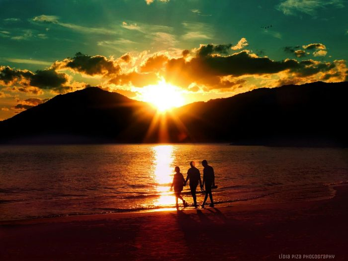 My Favorite Place Sunset People Family Taking Photos Togetherness Reflection Vacations Remote Tranquil Scene Sunlight Tranquility Sea Standing Mountain Idyllic Beauty In Nature Nature Beach Sun Scenics Water Silhouette People And Places TakeoverContrast