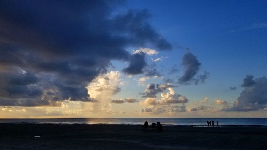 Family Family On The Beach Travel Sunrise Hilton Head Island, SC Ocean Clouds And Sky Backgrounds Water Sea Beach Power In Nature Blue Silhouette Sand Sun Sky Dramatic Sky