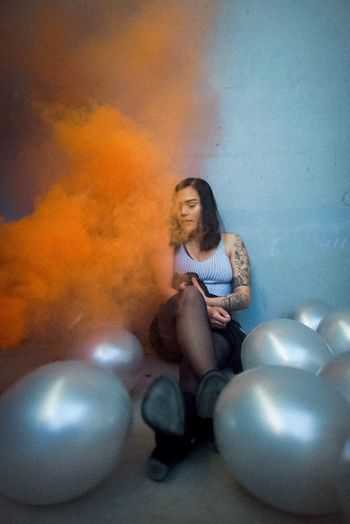 Birthday wish Orange Tattoo Birthday Balloon Smoke Bomb Smoke Full Length One Person Real People Sitting EyeEmNewHere EyeEmNewHere