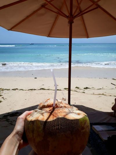 Close-up Coconut Drink Cocktail Bali Vacations Summer Paradise Water Sea Beach Sand Coconut Relaxation Motion Beach Umbrella Sunshade Lounge Chair Calm Island
