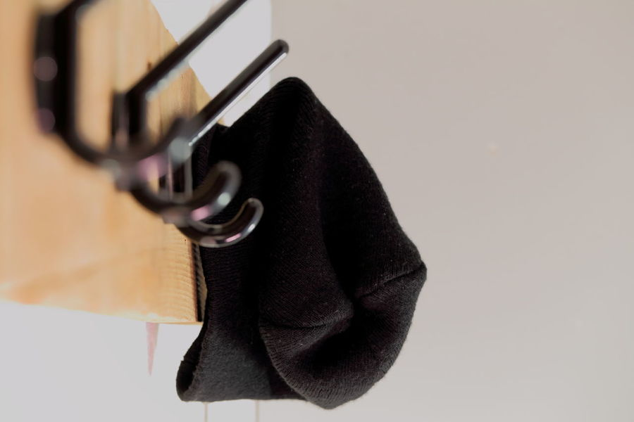 Cap on coat rack. Abandoned Autumn Black Cap Close-up Coat Rack Copy Space Welcome To Black EyeEm Best Shots Minimalist Architecture Interior Interior Design Left Lieblingsteil Minimalism No People Perspective Plastic Rack Still Life Warm Clothing White Background Winter Wood - Material Woolen Woolen Cap
