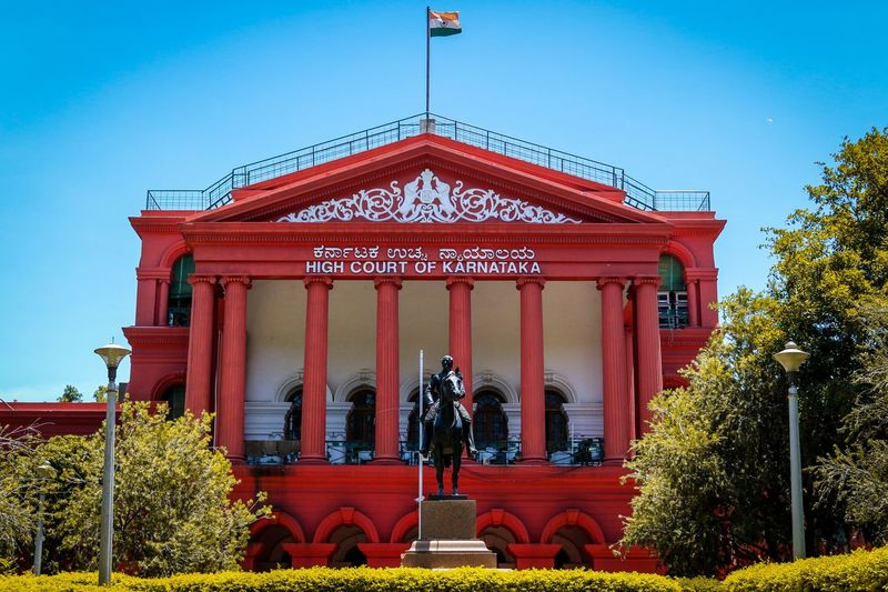 The Stunning High Court of Karnataka. India Government National Constitution Tricolor Indian Court Travel Traveller Canon Nature Scenery Scenics - Nature Architecture Tree Red Politics And Government Architectural Column Sky Architecture Plant Pavilion Historic Office Building Palace Historic Building Architectural Feature Building