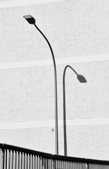 Street light in city against wall