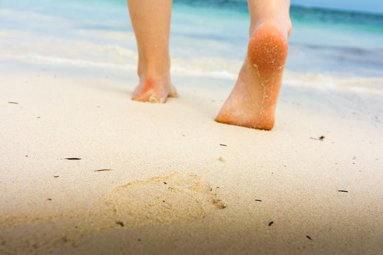 Girl's barefoot feet walking on white sandy caribbean beach BavaroBeach Calm Summertime Barefoot Beach Caribbean Close-up Feet Girl Health Care Human Body Part Human Leg Leisure Activity Nature One Person Outdoors People Punta Cana Sand Sea Sport Standing Summer Walking Water