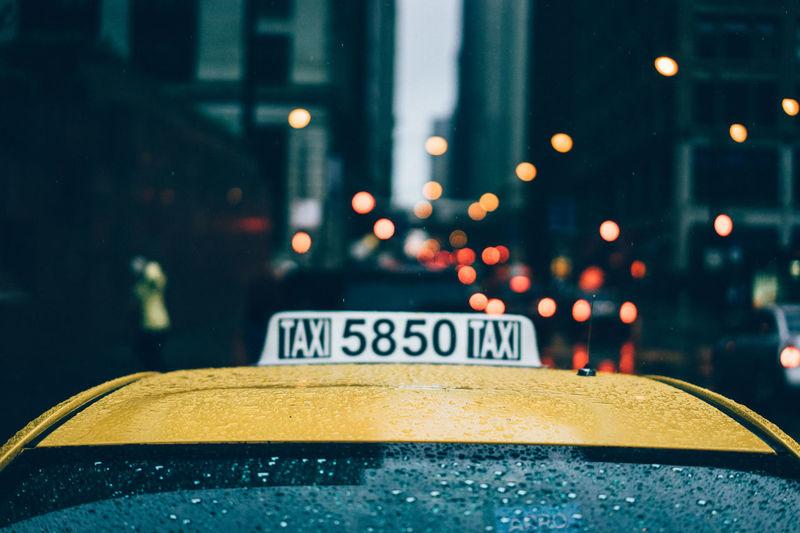 Taxi on street during rainy season
