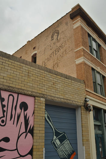 Heartbreak Hotel ghost sign in Memphis, Tennessee Elvis Presley Ghost Signs  Memphis Sign Architecture Building Exterior Built Structure Communication Day Elvis Ghost Signs  Heartbreak Hotel  Low Angle View No People Outdoors Sky Text