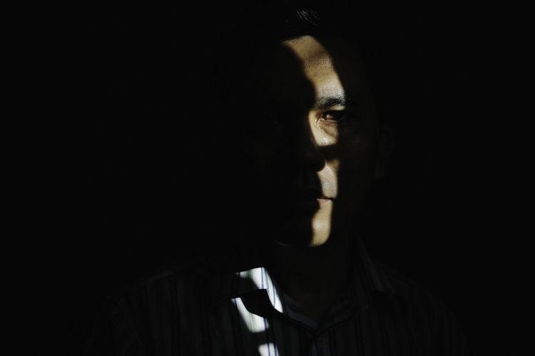 Close-Up Of Man In Darkroom