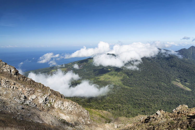 Looking down from the summit of Mount Egon on Flores Island in Indonesia. Hiking Tourist Travel Traveling Active Volcano Adventure Attraction Destination East Nusa Tenggara Egon Explore Flores Geology Gunung Hike Lanscape Maumere Mount Egon Mountain Southeast Asia Stratovolcano Tourism Trek Volcanic Landscape Volcano