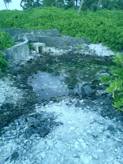 """end point of a """"Aar"""" - a local water drainage mechanism to prevent flooding, used in Fuvahmulah, Maldives. Sights fuvahmulah Maldives"""