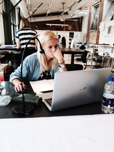 Working Young Women Blond Hair Laptop Women Technology Office Wireless Technology Communication Desk Computer Indoors  Only Women Young Adult Using Laptop Businesswear Business Businesswoman Connection