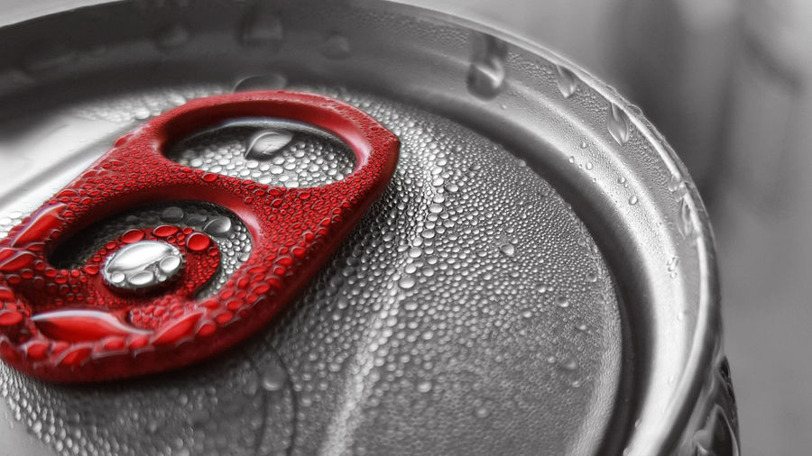 Black & white can with red detail / close up / water drops Black And White Blackandwhite Can Close-up Cold Dose Drops Drops Of Water Extreme Close Up Extreme Close-up Focus On Foreground Full Frame No People Part Of Red Red Detail Refreshing Refreshment Selective Focus