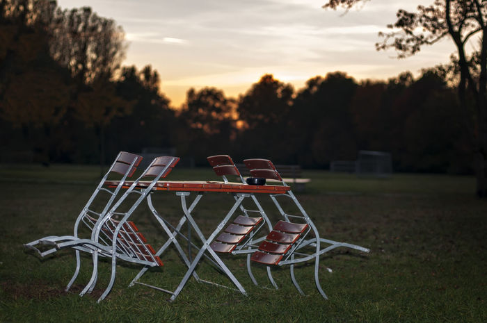 Absence Autumn Beer Garden Chair Dusk, Sunset, End Of Summer Time, Grass Nature No People Outdoors Park, Sky, Sunset Tranquility Tree