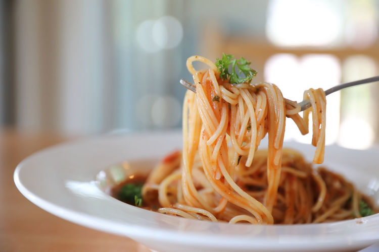 Close-up of noodles in plate on table